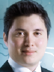 A profile photo of Simon Akozu